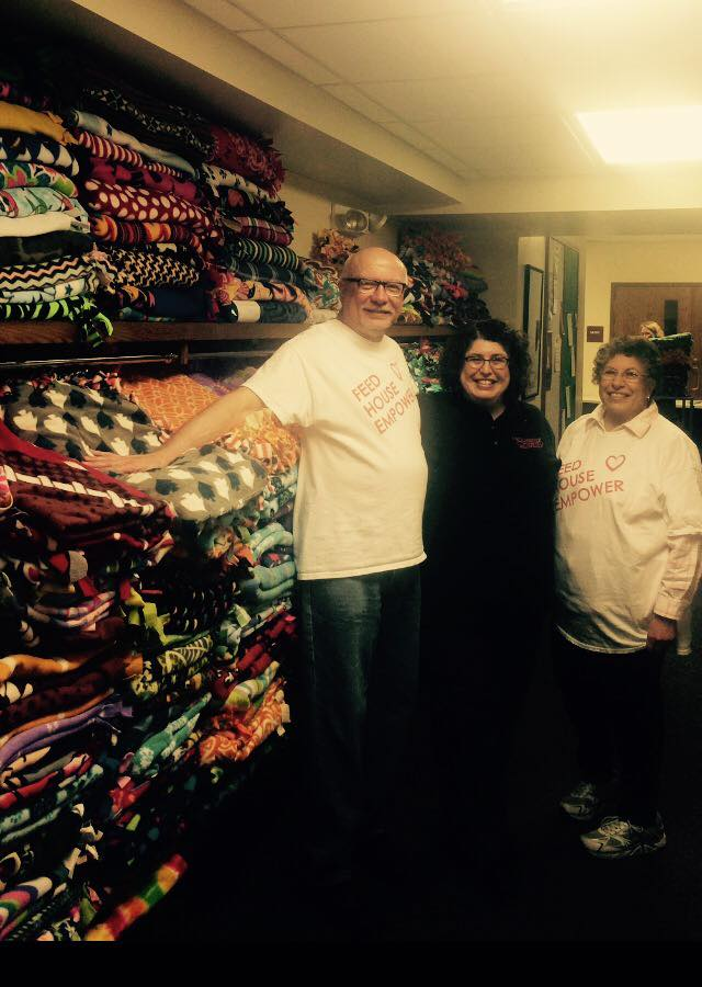 Pictureof HOC staff collecting blankets donated