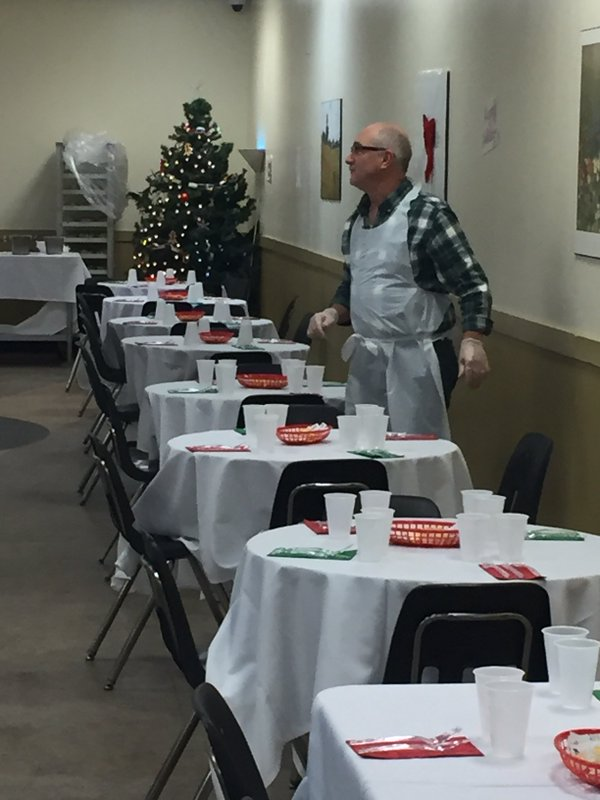 Volunteers waiting to serve the holiday meals to guests